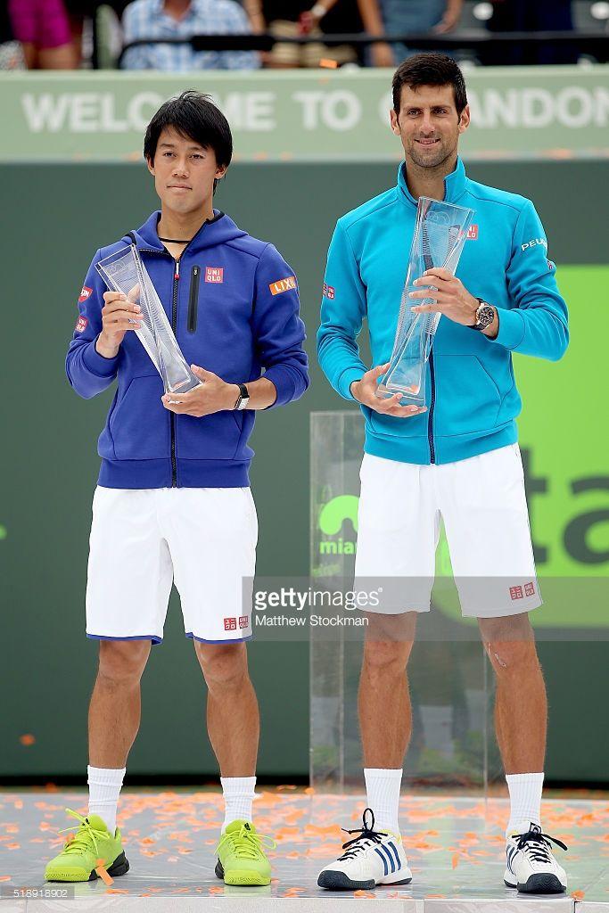 Kei Nishikori of Japan and Novak Djokovic of Serbia pose for photographers after…