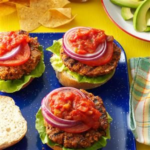 Black Bean Chip & Dip Burgers Recipe -I tried to create a healthy veggie burger that wasn't dry and crumbly or really boring. These fit the bill because even my grandkids prefer them over hamburgers. They taste like chips and dip in a burger! —KT Rehrig, Allentown, Pennsylvania