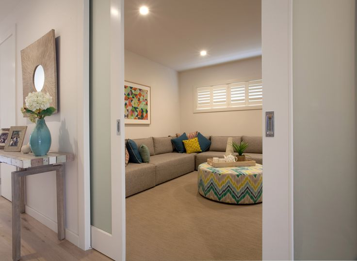 We love these sliding doors so you can open up the room or close it off from the hall. Also a gorgeous hall table!!