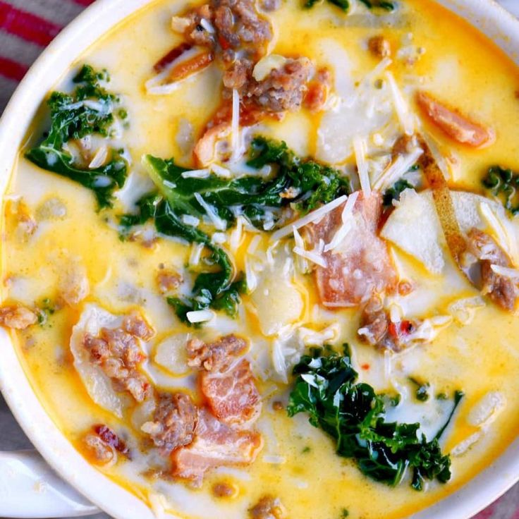 The whole family will love this copycat One Pot Olive Garden Zuppa Toscana Soup! Comfort food at it's best! Loaded with bacon, sausage, potatoes, and kale!