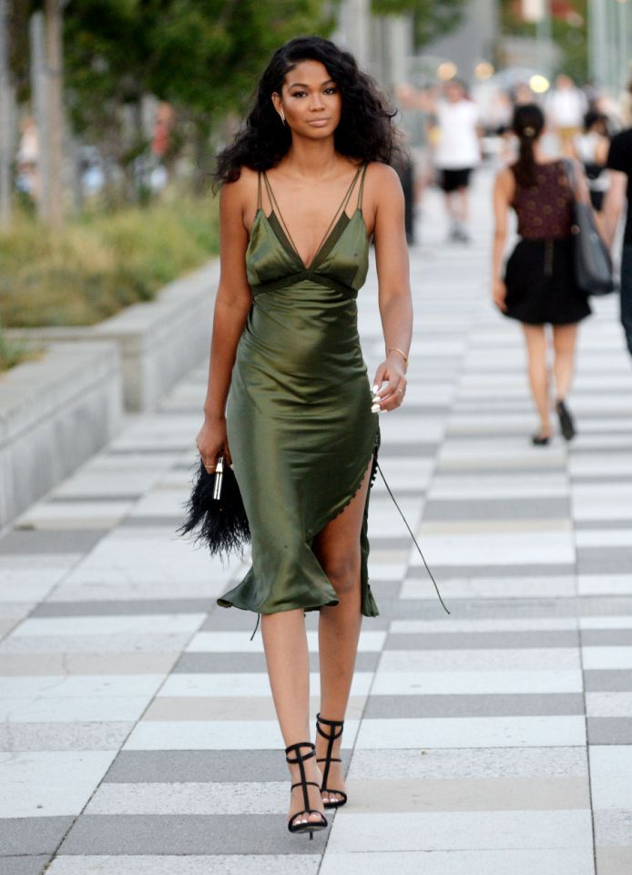 Chanel Iman in New York City - August 18, 2015 Tip: The slip dress is most definitely back. No '90s girl would be without her slinky slip dress — Just ask Carolyn Bessette-Kennedy, who famously wore a gown by the king of the bias-cut, Narciso Rodriguez, on her wedding day. Here, model Chanel Iman shows us the look's still got legs in her Alexander Wang dress, accessorized perfectly low-key with strappy heels and unfussy hair. Shop the look: Alexander Wang Satin Midi Dress, $1,295…