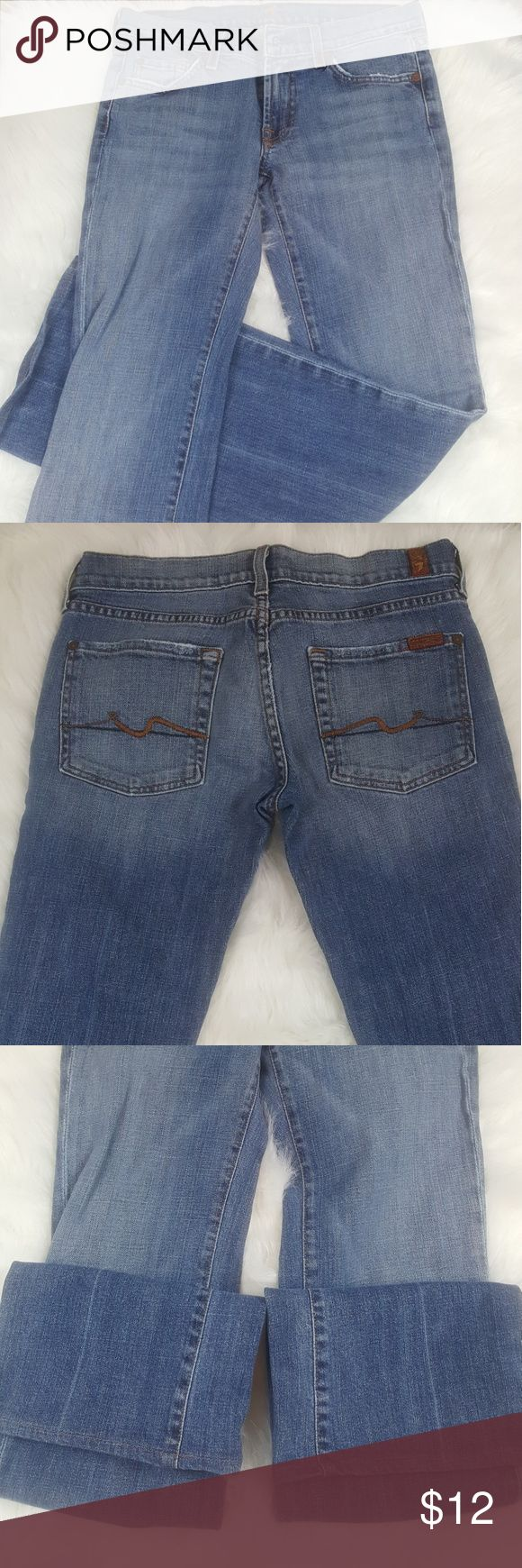 7 For All Mankind Women's Jeans Size 27 Womens light blue denim jeans 7 For All Mankind brand. Size 27 Boot Cut style. Small stain on right knee as pictured. In great condition other than that.  Measurements:  Waist: 30 inch  Hips: 17 inches Inseam: 32 1/2 inches Rise: 8 inches Cuffs: 9 inches 7 For All Mankind Jeans Boot Cut