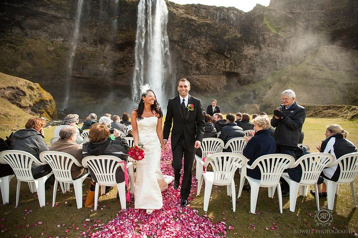 Such a picturesque location for an Iceland wedding ceremony; Seljalandsfoss.  Just before they walked down the aisle the sun crested over the mountain and shown down on everyone as they watch the newly weds walk down the aisle of their Iceland wedding.