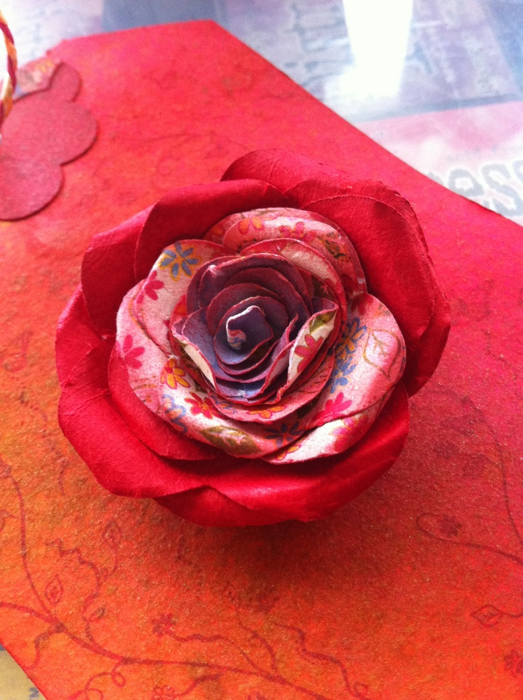 Rolled roses using a Kaszazz EzyPress die with 'Terrace Garden' scrapbook paper sprayed with Dylusions ink. Much faster than handcutting scallop spirals :)