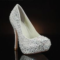 Covered in Duchesse silk and genuine Swarovski crystals, this gorgeous pump is perfect for the true fashionista bride! The covered platform style has a 4 3/4 inch heel height and is available in sizes 5 and 6-10. This stunning shoe is also great when paired with a cocktail dress for a night out!