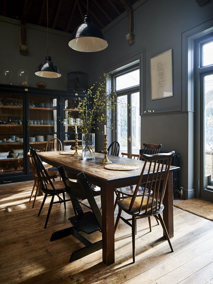 The kitchen/dining walls are painted in Farrow & Ball's Mole's Breath. The vintage industrial lights are from Stroud company Trainspotters.