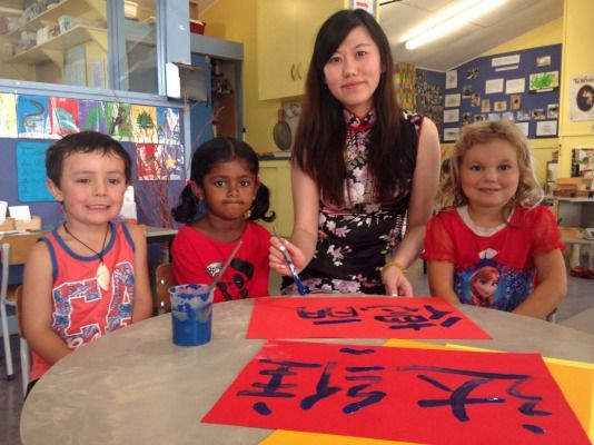 Annie Snow paints Chinese characters Maesyn Jones, from left, Delisha Singh and Devana Spivey at Rhona Day Kindergarten. The Temuka kindy was celebrating Chinese New Years.