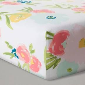 """Set baby down to sleep in a bed of roses with this Pink Floral Fitted Crib Sheet from Cloud Island™. Watercolor style flowers decorate the soft 100 percent cotton fitted crib sheet for beautiful pops of color to go with your nursery decor. Keep the flowers fresh with the full elastic, keeping the sheet fitting snugly wash after wash. <br><br>Sleep Safely, Little One<br>When putting baby to sleep, """"Bare is Best"""" in the crib. Use a firm, tight-fitt..."""