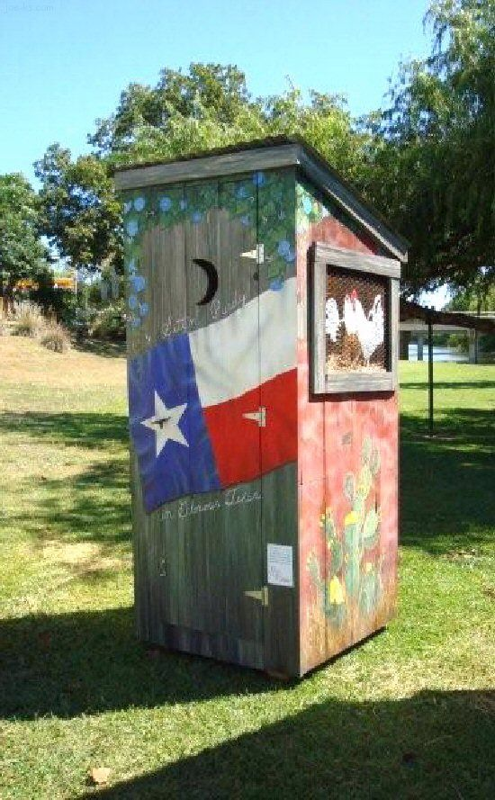 outhouse with framed art