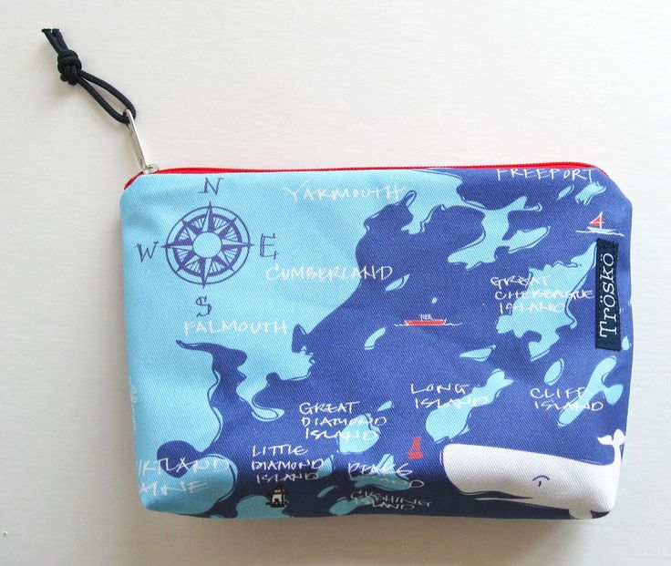 "Casco Bay zippie bag. Featuring the 5 Casco Bay islands on the mail boat route. A handy zippered pouch for stashing anything that needs stashing and organizing. The fabric is 100% cotton twill printed with water-based inks in the US. The lining is water-repellent yellow nylon and red YKK zipper. The pouch is about 8"" wide, 5"" tall, 2"" at the base and has a marine grade pull cord on the zipper. All design and sewing done in Yarmouth, Maine."