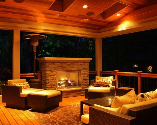 Incredible covered deck with modern tropical patio furniture completed with outdoor fireplace - Incredible central fireplace ideas ...