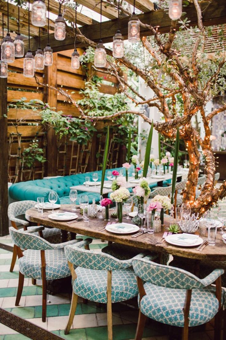 Outdoor party: I love the lights hanging, the chairs + dining bench, and other details, but wouldn't choose a rustic table and change some other things about the atmosphere. Al fresco dinner party.