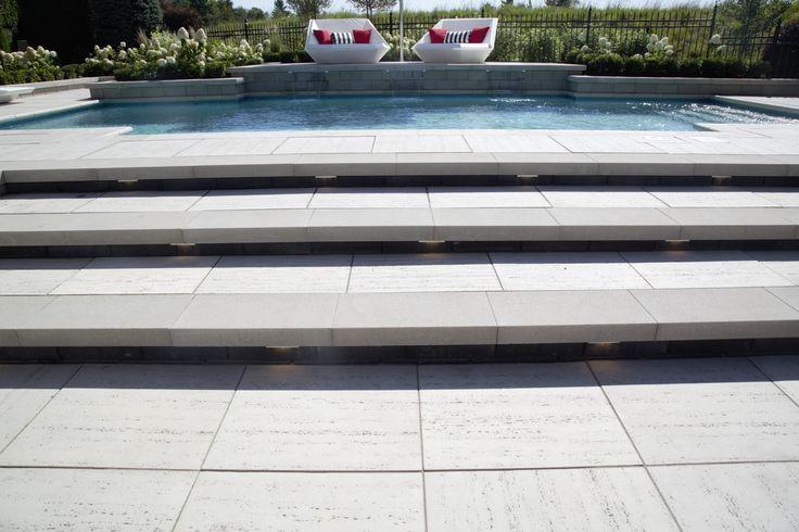 Pool Stairs - Groupe Paramount #poolstairs #steps #designinspo #pavers #poolpavers #stairlighting