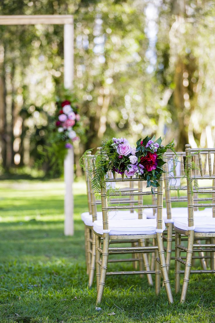 Wedding ceremony chair - Fresh Floral Arrangement On Aisle Way Chairs For This Elegant Wedding Ceremony