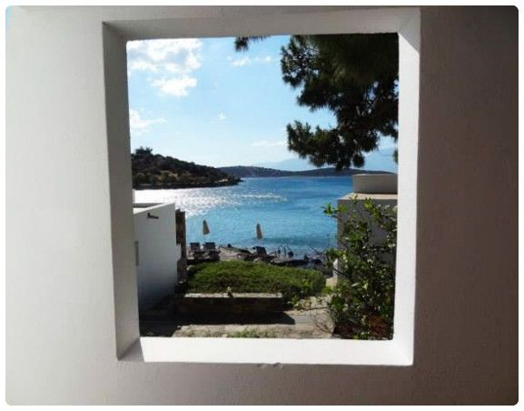 Our guest Colin Topping is enjoying the sea view from the window of her bungalow!