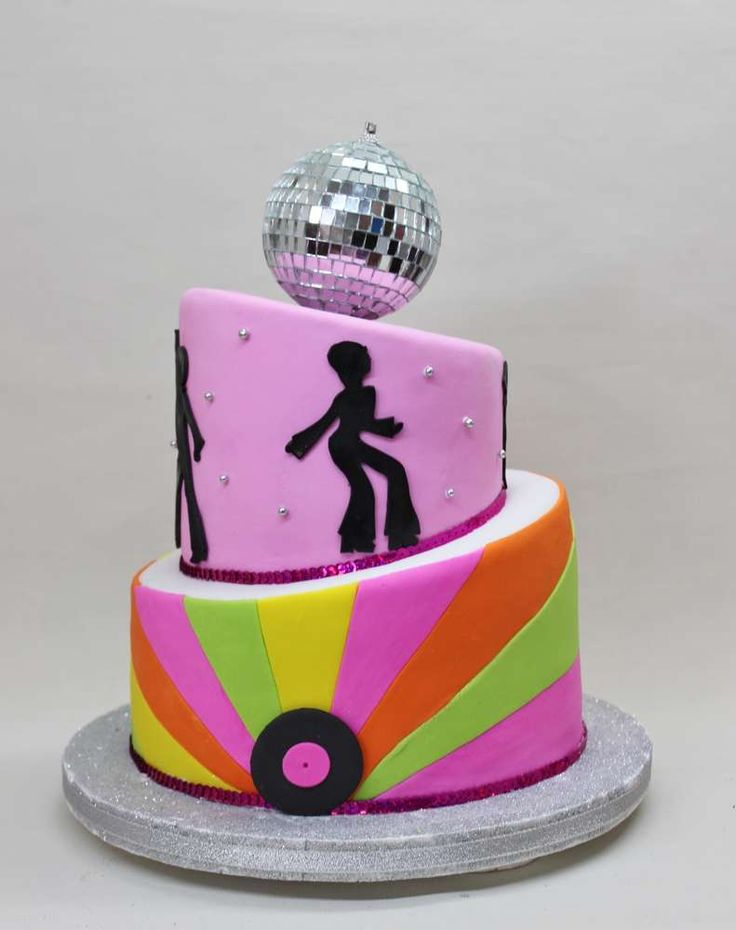 Disco ball topped cake at a girl birthday party! See more party planning ideas at CatchMyParty.com!