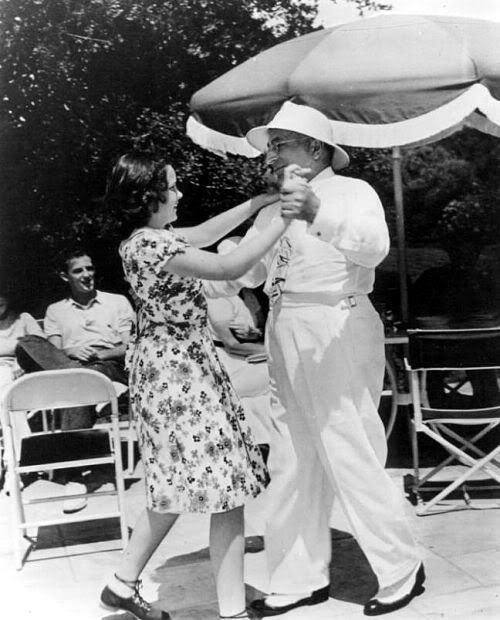 Judy Garland and boss Louis B. Mayer frolic at an M-G-M get-together in 1936