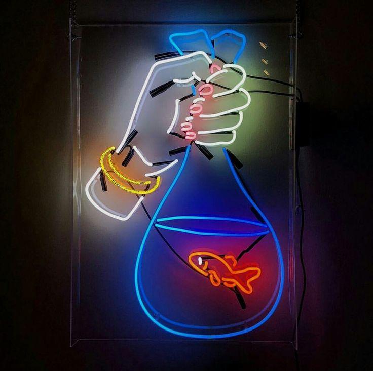 Neon Goldfish in Hand