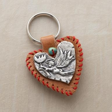 "Jes MaHarry's keyring puts meaning into everyday comings and goings. Her heart medallion bears a guardian angel. Crafted of pewter and leather. Handmade in USA exclusively for us. Approx. 1-1/2""W x 2-1/2""L."