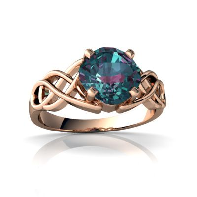 My birthstone on a Celtic infinity weave -Alexandrite ring. I can't handle how stunning this is.