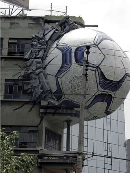 Awesome Outdoor Ads: Giant Nike soccer ball bursting out of a building. SO COOL