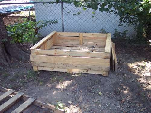 Raised veggie planters out of old pallets!