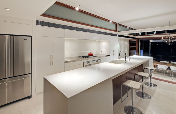 Kitchen: Showing a closer view of the island in Corian® Designer White. Jarrah Bar Backing under