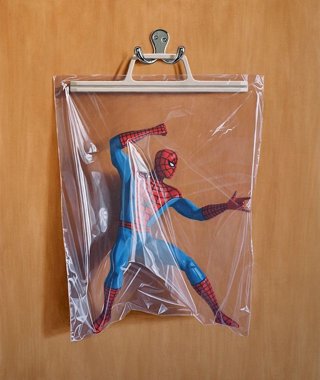 Essex, England based artist Simon Monk conceals the masks that conceal the alter-egos of a few well known comic book heroes in his ongoing photorealistic Secret Identity painting series.