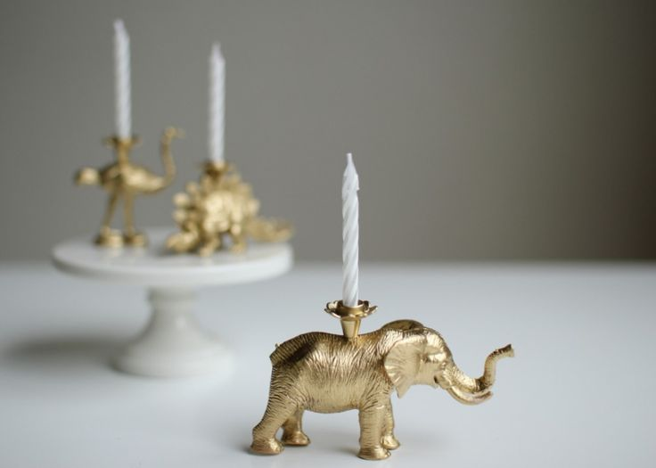 Make your own candle holder by drilling a hole in a plastic animal then inserting a candle holder and candle.