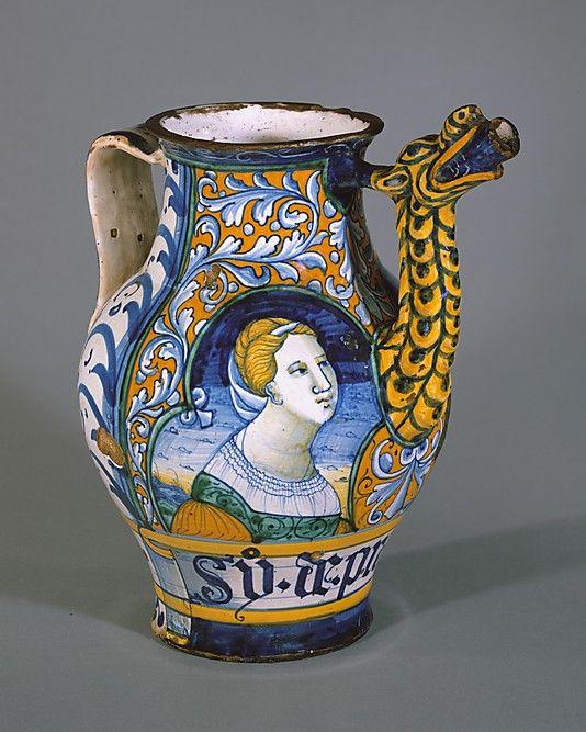 Apothecary jar (orciuolo) MMoA  Date:     ca. 1520 Culture:    Italian, Castelli Medium:    Maiolica (tin-glazed earthenware) Dimensions:    Height: 9 13/16 in. (24.9 cm)