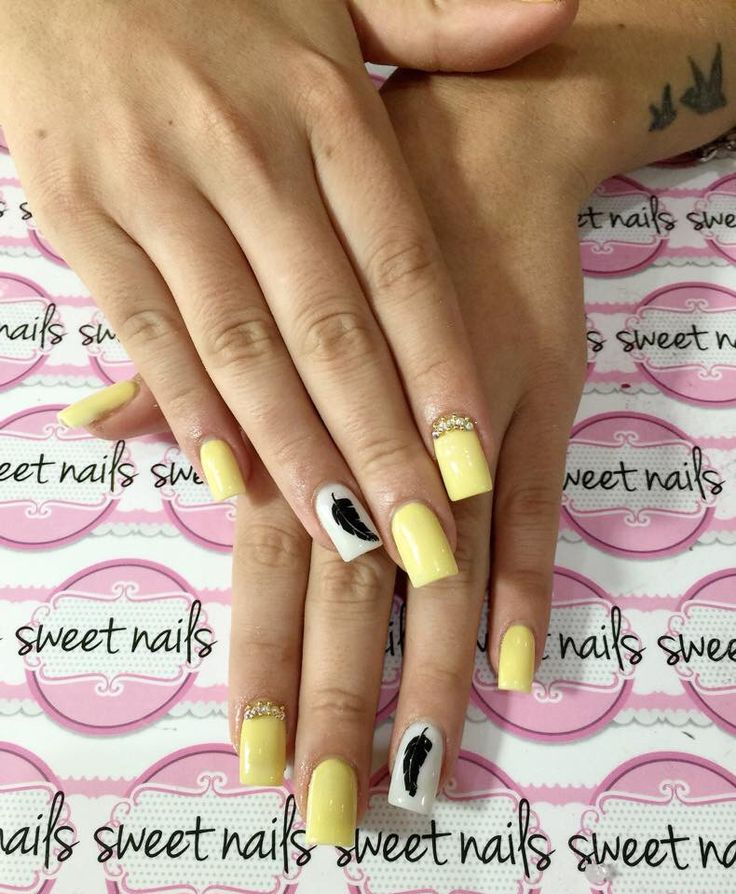Yellow feather nails
