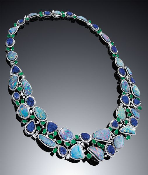 Cellini Jewelers. Cellini Opal Collection. Opal and tanzanite necklace, framed with brilliant cut white diamonds and accented with fancy cut emeralds and diamonds. Set in 18-karat White gold.  Tanzanite 114.80ct, Emerald 10.88ct, Diamond 11.95 ct.