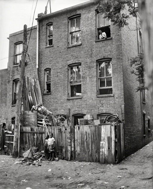 "1935. ""Row houses in Washington, D.C."" Running the vertical gamut from natty to gritty. Harris & Ewing Collection glass negative."