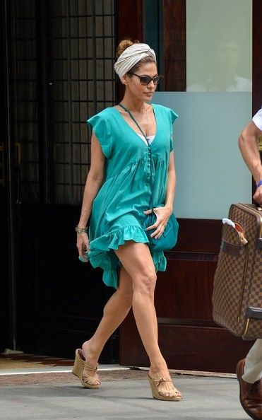 Eva Mendes tries to control her short dress as she exits a hotel in downtown Manhattan.