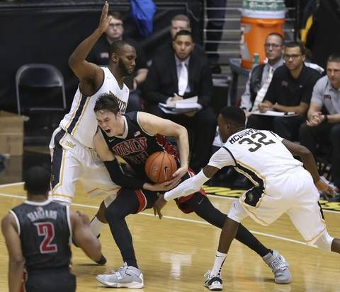 UNLV forward Stephen Zimmerman Jr. tries to get past WSU defenders Shaq Morris, left, and Markis McDuffie during the second half of their game at Koch Arena on Wednesday night.