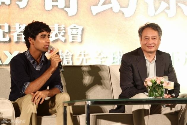 Oscar-winning movie director, Ang Lee, and Suraj Sharma, the hero (young Pi) of the film speaking into MIPRO ACT-7H handheld transmitter.