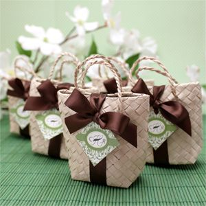 """Create an elegant beach or destination wedding by placing delicious treats or small gifts inside these natural mini palm leaf favor bags. Each favor bag measures 3.5"""" L x 3"""" H x 1.25"""" width. Personalize using our small diamond shaped hang tags and tie a bow using our 5/8"""" satin ribbon (sold separately)."""