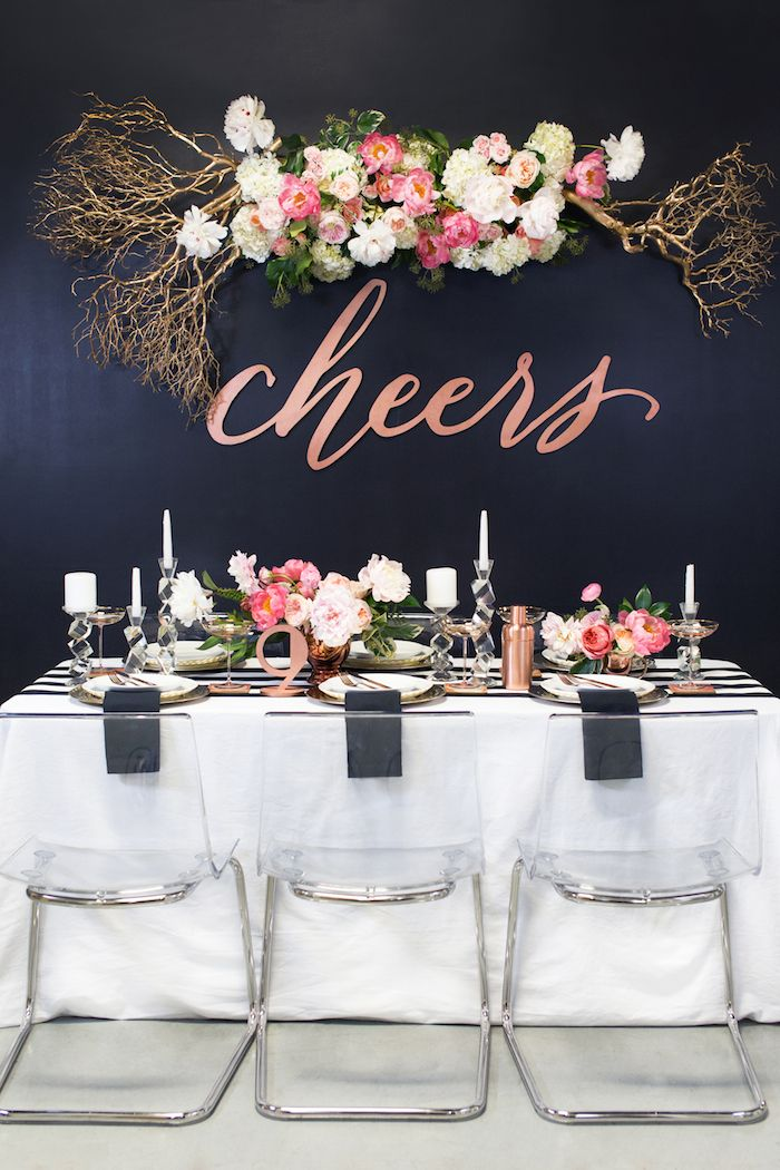 modern wedding decor - especially love the 'cheers' sign and suspended florals via @perfectpalette