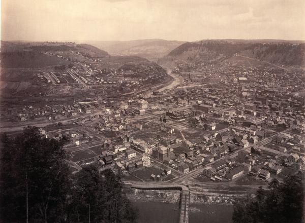 A view of Johnstown, from the top of the Inclined Plane at Westmont, by William H. Rau. In the center of the scene is Johnstown Passenger station and The Cambria Iron Works, which later became Bethlehem Steel is at the far left.