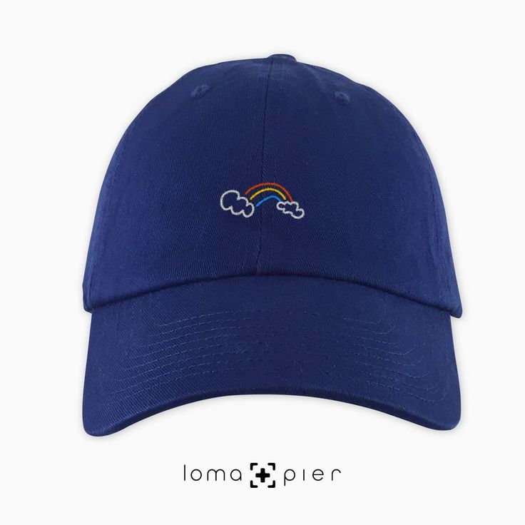 RAINBOW typography embroidered on a royal blue unstructured dad hat with multicolor thread by loma+pier hat store made in the USA. RAINBOW dad hat is 100% cotton unstructured with a pre-curved bill and an adjustable self strap with a hide-away side buckle. it features RAINBOW typography embroidered on the front with a small loma+pier logo on the left side. each order is custom made in the USA and can only be found in the loma+pier hat store.