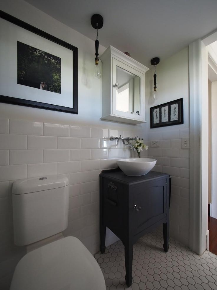 Toilet suite, traditional vanity, bevelled edge subway tiles and mosaic floor tiles.