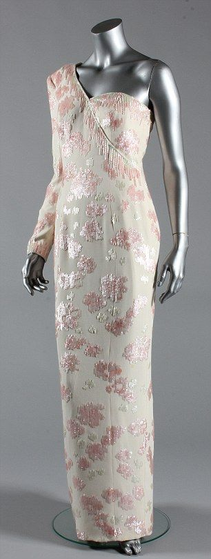 This pink sequined ivory crepe gown, by Catherine Walker worn by Diana, Princess of Wales in 1991 will be on show.