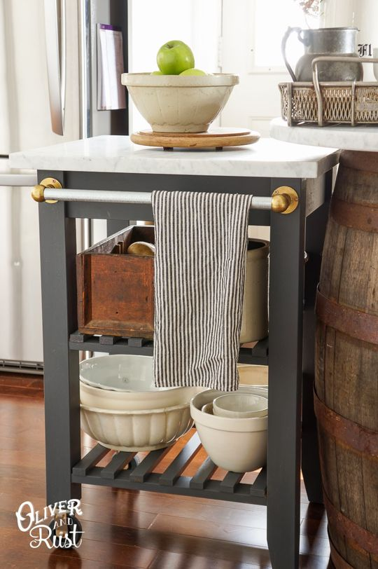 IKEA Hacks that Look Like a Million Bucks.  This humble Bekvam kitchen cart got an elegant update from the blogger at Oliver and Rust with some paint, a Carrara marble top, and a vintage brass towel holder.