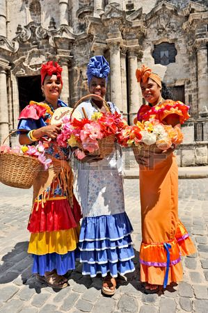 HAVANA CUBA MAY 6 2009 Three Cuban women in traditional dresses in Havana Cuba on May 6th 2009 Stock Photo