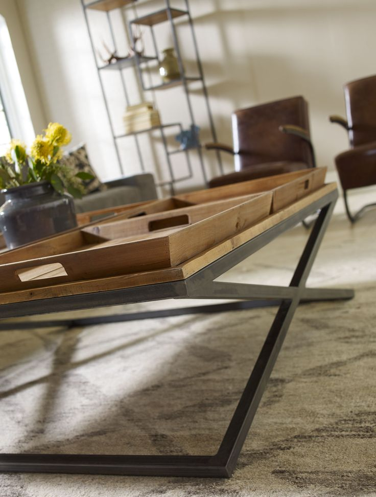 A coffee table with removable trays on top, how perfect for serving appetizers in the living room!!