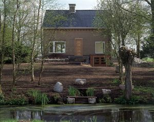 """Here I organized and took part in extensive land works: to enlarge and clear the pond and the mote, create new paths, enhance the position of the house as an observation center, etc.  I literally spent days pollarding willows, planting hedges, and seeding wild flower and grass borders…And so we ended it up with  """"The Ideal Artist Pond"""", """"The Wandering Stones""""–ancient boulders strewn across the lawn, and even """"The Ideal Artist Shower"""" (with hot water """"on tap"""")."""