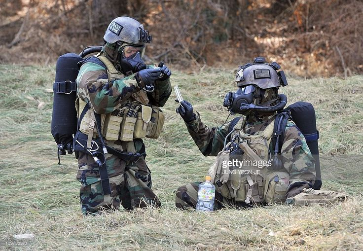 US soldiers wearing chemical warfare gear check a sample during a joint military exercise with South Korea at a US Army base in Dongducheon, 40kms north of Seoul, on March 3, 2011 aimed to simulate the detection and disposal of North Korea's chemical, biological, radiological and nuclear weapons. US and South Korean soldiers displayed their techniques for handling weapons of mass destruction (WMD) in the face of North Korea's nuclear sabre-rattling.