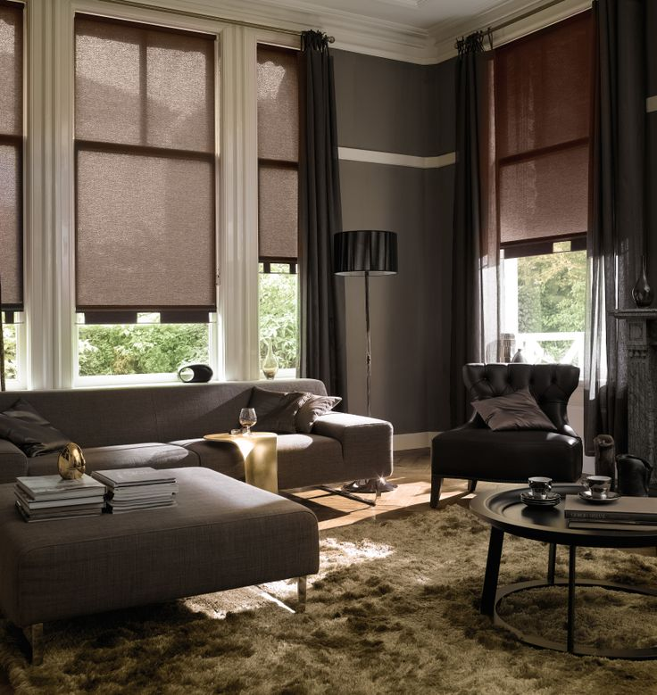 This dark neutral palette creates an alluring relaxed warmth in this living room with Hunter Douglas Roller Shades #WindowTreatments