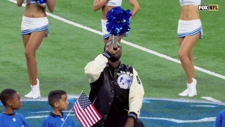 At the end of the national anthem before today's Falcons-Lions game in Detroit, singer Rico LaVelle dropped to one knee and put up a fist.