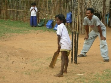 Street Cricket Player India. So lovely. You don't need a lot of equipment to play. Have a look at the bat and the stumps!